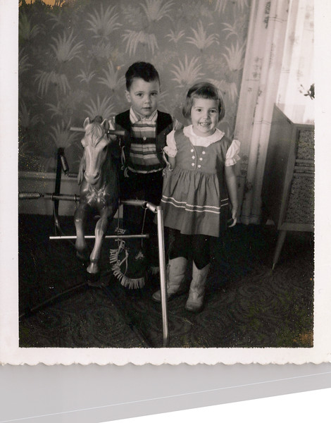 1950s Butch and girl with rocking horse.jpeg