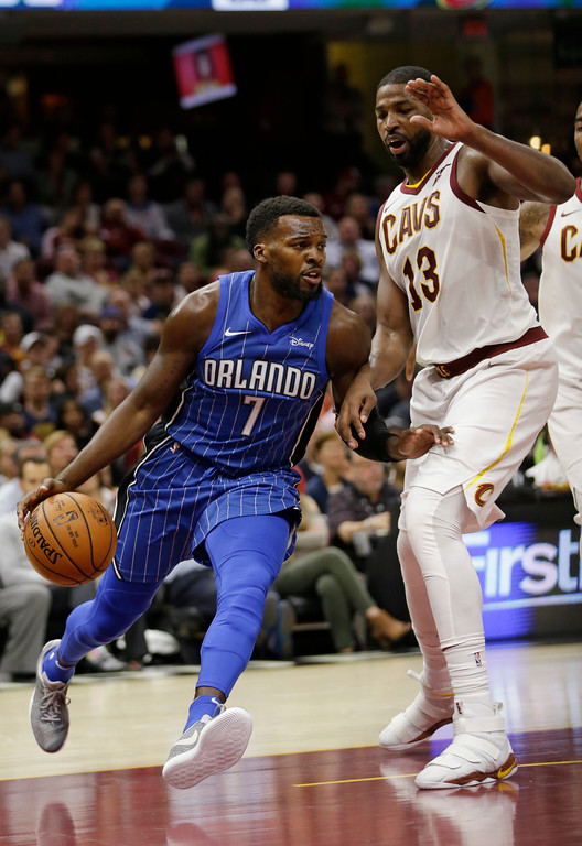 . Orlando Magic\'s Shelvin Mack (7) drives past Cleveland Cavaliers\' Tristan Thompson (13) in the second half of an NBA basketball game, Saturday, Oct. 21, 2017, in Cleveland. (AP Photo/Tony Dejak)
