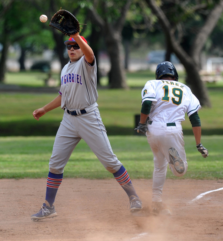 . San Gabriel first baseman reaches for the ball as Schurr\'s Jacob Perez is called out at first base in their Almont League game at Whittier Narrows Recreation Area in South El Monte on Friday April 5, 2013. San Gabriel beat Schurr 8-5. (SGVN/Staff Photo by Keith Durflinger)