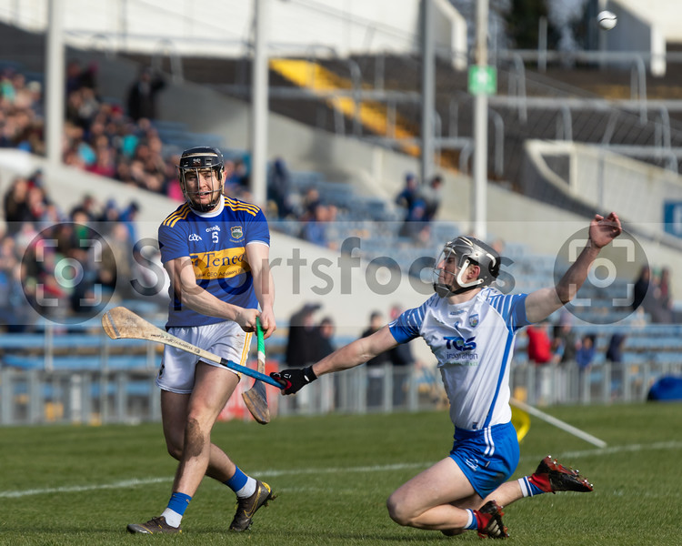 Alan Flynn of Tipperary gets his shot away before Jamie Barron of Waterford can get the block in