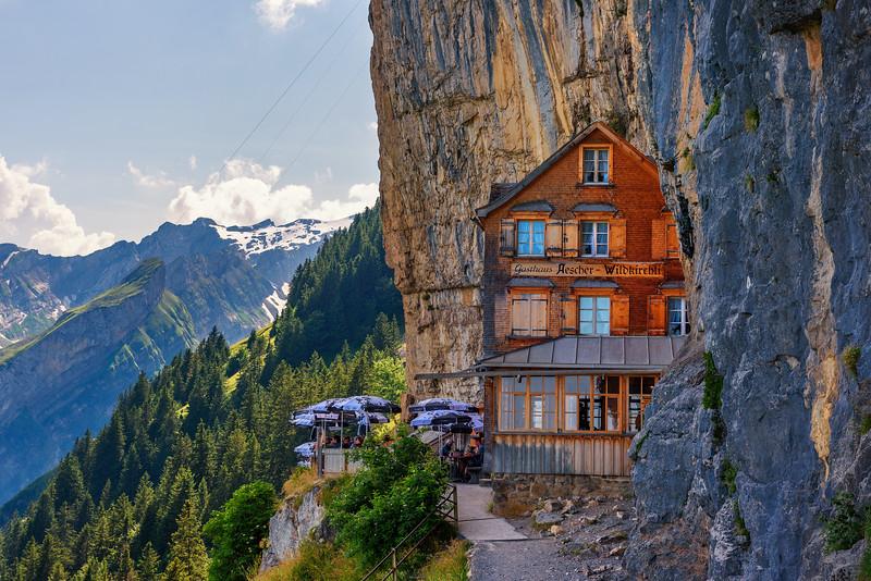 Guest house Aescher-Wildkirchli under a cliff on mountain Ebenalp in Switzerland