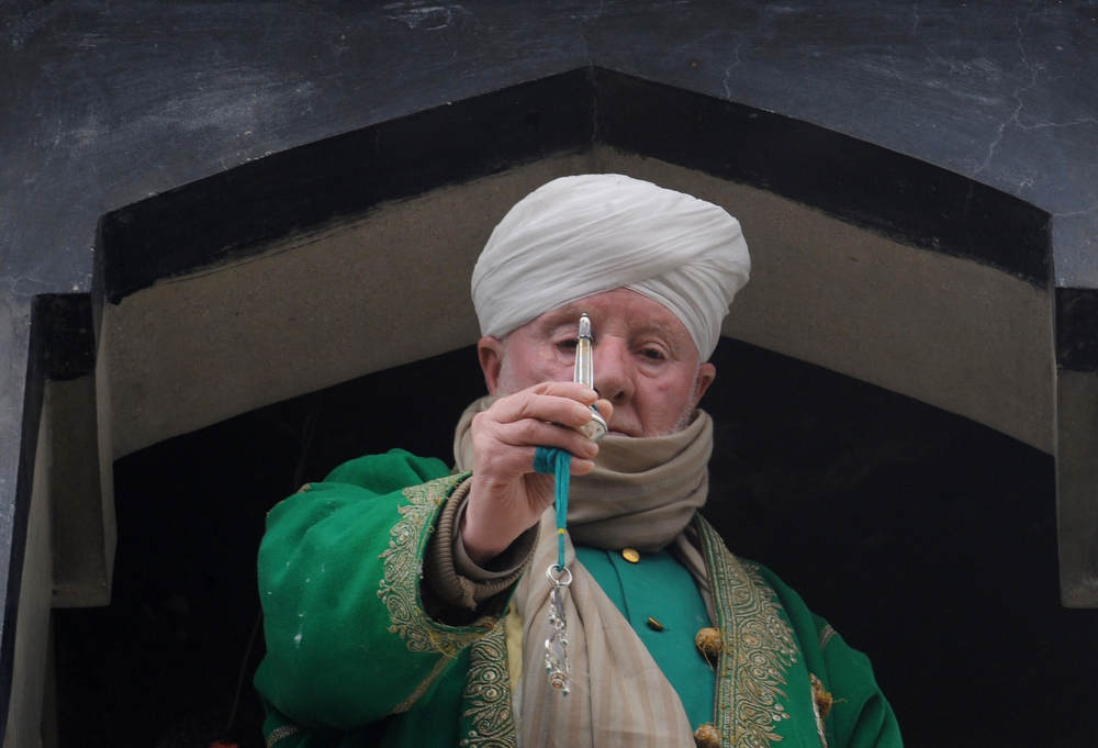 . Kashmiri Muslim cleric Peer Hisam-u-Din-Banday displays a holy relic believed to contain a hair from the beard of Prophet Mohammed during Eid-e-Milad-un-Nabi, the birthday of the prophet, at the Hazratbal Shrine in Srinagar on January 14, 2014. Thousands of Kashmiri Muslims gathered at the shrine in the summer capital of Jammu and Kashmir to offer prayers on the Prophet\'s birth anniversary. (ROUF BHAT/AFP/Getty Images)