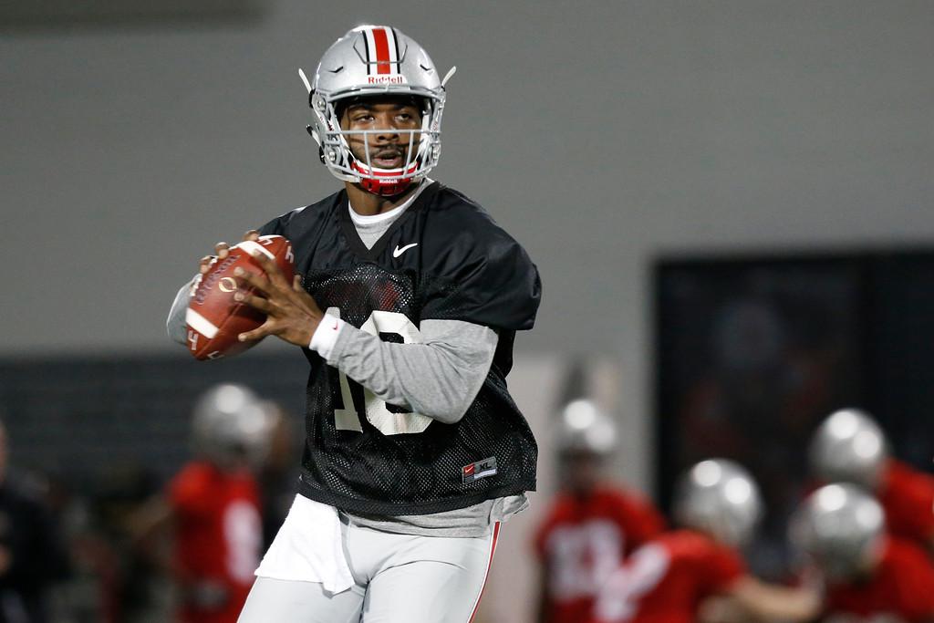 . Ohio State quarterback J.T. Barrett runs a drill during their Spring NCAA college football practice Tuesday, March 7, 2017, in Columbus, Ohio. (AP Photo/Jay LaPrete)