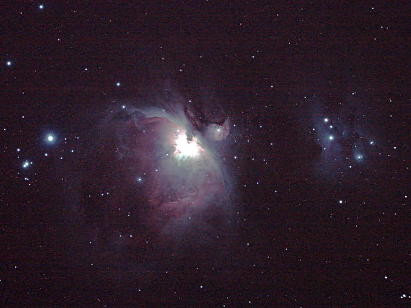 Messier M42 NGC1976 Orion Nebula - 3/1/2011 (Processed and cropped stack)   The 'Great Orion Nebula' is located in the sword of Orion and is one of the brightest nebula in the sky, and perhaps the best known. It is a young star formation region with very hot high-UV stars ionising and 'lighting' the nebula.The brightness of these young stars make this an astrophotography challenge as the central regions are very bright in comparison to the tenous outer nebula and over exposure becomes a problem. High Dynamic Range (HDR) techniques must be used to produce an image with a 'flattened' brightness range, more akin to the way the human eye perceives a wide range of brightness.   To the northeast (right as shown) of the Orion Nebula is the 'Running Man Nebula' a blue reflection nebula, caused by reflected light on a dark non-ionised region of nebulosity.   HDR initial attempt, done in mid-2011, using DeepSkyStacker 3.3.2 Stacking 80% of:  12 Images ISO 800, 15 Sec, 6 DARK, 0 BIAS, 0 FLATS (see also separate stack)  6 Images ISO 800, 30 Sec, 32 DARK, 0 BIAS, 0 FLATS (see also separate stack)  20 Images ISO 800, 120 Sec, 11 DARK, 0 BIAS, 0 FLATS (see also separate stack)  Post processed with Adobe Photoshop CS4.  I failed to get the colour balance right here and pushed to far into the blue, which highlights the Running Man, but at the expense of reds in the Orion nebula. See my re-processed attempt in this gallery.  Telescope - Apogee OrthoStar LOMO 80/480 with Hotech SCA T-Adapter, Hutech IDAS LPS-P2 filter, Canon 400D DSLR, Ambient xxC (not recorded). Mount - Skywatcher NEQ6 Pro. Guidescope - Orion ShortTube 80 with Star Shoot Auto Guider.