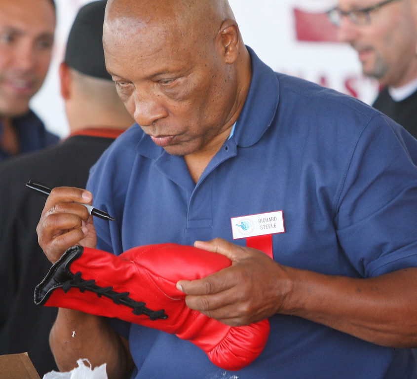 . International Boxing Hall of Fame Class of 2014 inductee Richard Steele signs an autograph after having fist cast at the hall of fame on Friday, June 6, 2014 in Canastota. JOHN HAEGER-ONEIDA DAILY DISPATCH @ONEIDAPHOTO ON TWITTER
