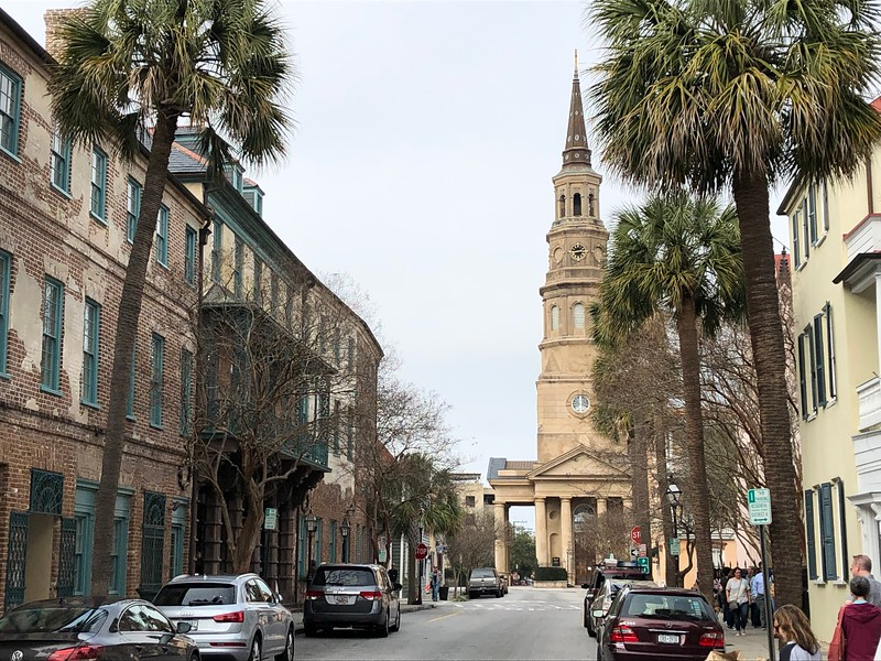 street scene with church steeple at the end