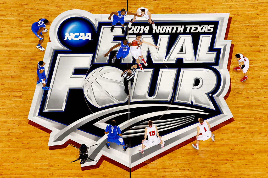 . ARLINGTON, TX - APRIL 05:  Frank Kaminsky #44 of the Wisconsin Badgers and Julius Randle #30 of the Kentucky Wildcats jump for the opening tip during the NCAA Men\'s Final Four Semifinal at AT&T Stadium on April 5, 2014 in Arlington, Texas.  (Photo by Tom Pennington/Getty Images)