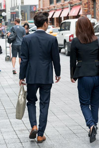 Business executives walking on sidewalk, Seoul, South Korea