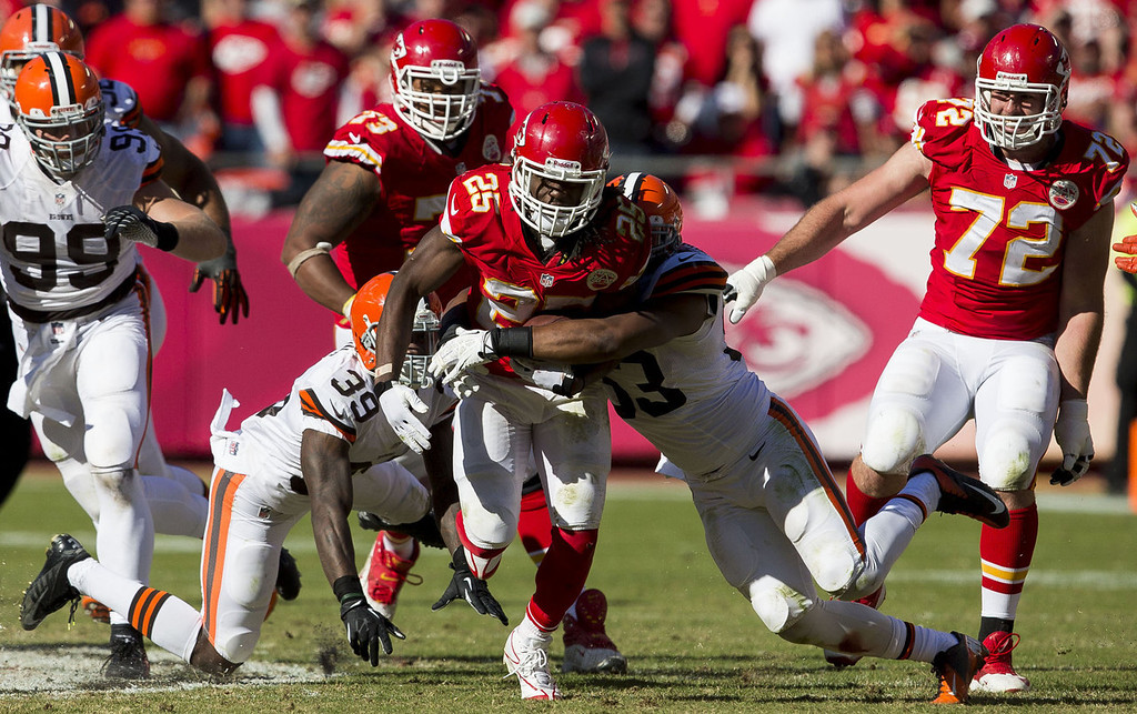 . Running back Jamaal Charles #25 of the Kansas City Chiefs is tackled by inside linebacker Craig Robertson #53 of the Cleveland Browns after breaking off a run during the game at Arrowhead Stadium on October 27, 2013 in Kansas City, Missouri. (Photo by David Welker/Getty Images)