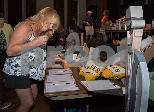 09/21/17 Wesley Bunnell | Staff Gail Boughton of New Britain looks over raffles prizes at the 6th Annual BENefit for the NBHS Marching Band. The annual fundraiser is in memory of Ben Cheney, a 2008 graduate who passed away.