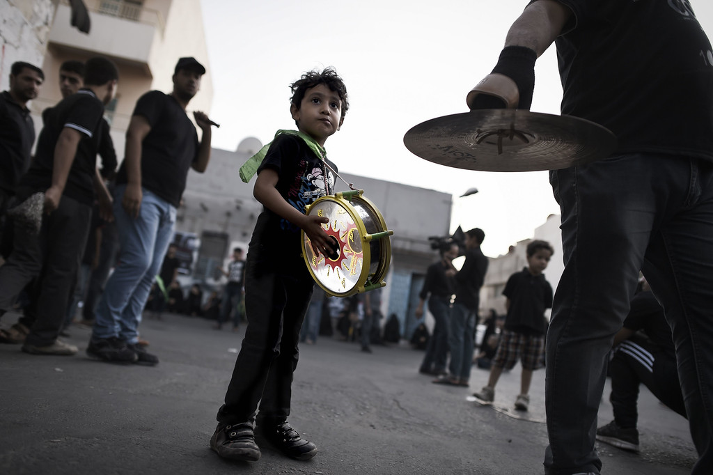 . A Bahraini Shiite Muslim boy takes part in a ceremony marking Ashura, which commemorates the seventh century slaying of Imam Hussein, the grandson of Prophet Mohammed, in the village of Sanabis, west of Manama on November 1, 2014. MOHAMMED AL-SHAIKH/AFP/Getty Images