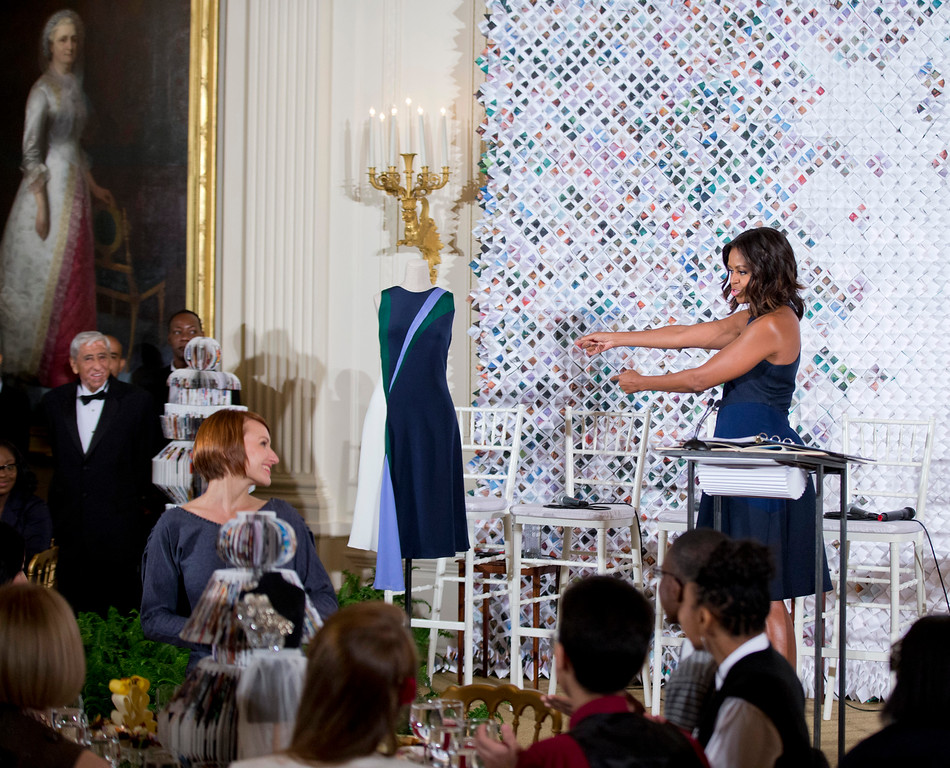 . First lady Michelle Obama introduces Natalya Koval, left, a student from Fashion Institute of Technology, who won a design competition, during the Fashion Education Workshop at the White House in Washington, Wednesday, Oct. 8, 2014. Natalya Koval, designed the first lady�s navy sleeveless dress with a full skirt and a racer style front she is wearing. (AP Photo/Manuel Balce Ceneta)