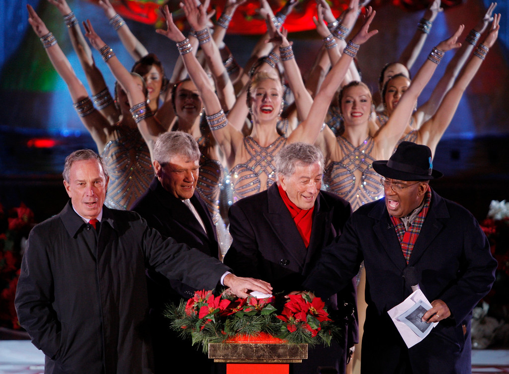 . From left: New York City Mayor Michael Bloomberg, Jerry Speyer, CEO of Tishman Speyer, Tony Bennett and Al Roker hit the switch together as the Radio City Rockettes perform to light up the Rockefeller Center Christmas tree during the 75th tree lighting ceremony Wednesday, Nov. 28, 2007 in New York.(AP Photo/Julie Jacobson)