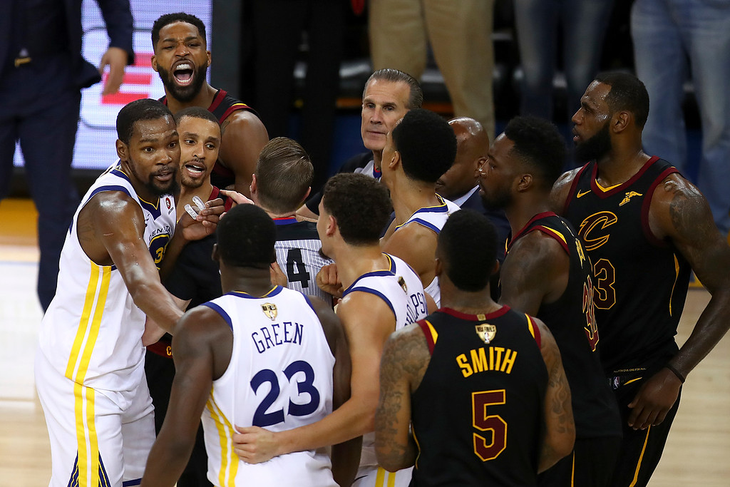 . Cleveland Cavaliers center Tristan Thompson, top left, yells at Golden State Warriors forward Draymond Green (23) during overtime of Game 1 of basketball\'s NBA Finals in Oakland, Calif., Thursday, May 31, 2018. The Warriors won 124-114. (AP Photo/Ben Margot)