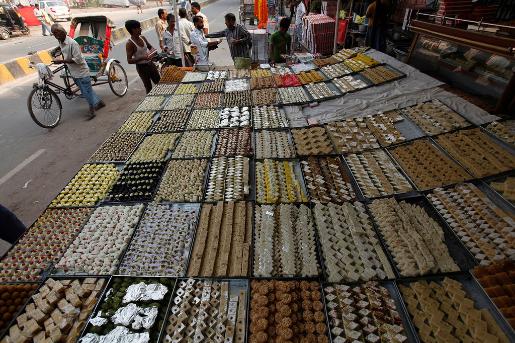. Traditional sweets are displayed for sale at a wayside shop during the Diwali festival in Allahabad, India, Sunday, Nov. 3, 2013. Hindus light lamps, wear new clothes, exchange sweets and gifts and pray to goddess Lakshmi during the festival of lights, that is celebrated on Nov. 3. (AP Photo/Rajesh Kumar Singh)