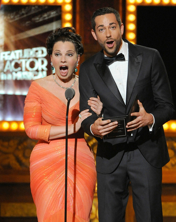 . Fran Drescher and Zachary Levi present the award for best performance by an actor in a featured role in a musical on stage at the 68th annual Tony Awards at Radio City Music Hall on Sunday, June 8, 2014, in New York. (Photo by Evan Agostini/Invision/AP)