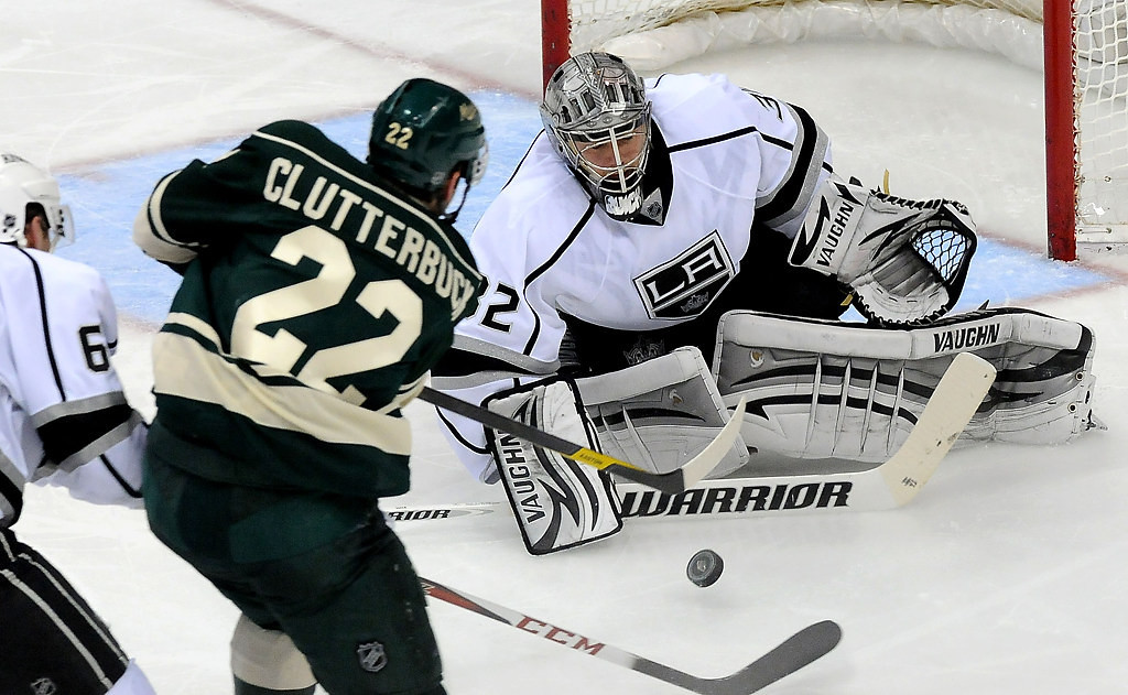 . Minnesota Wild\'s Cal Clutterbuck (22) shoots on Los Angeles Kings goalie Jonathan Quick as the Kings\' Jake Muzzin defends during the second period. (Pioneer Press: Sherri LaRose-Chiglo)