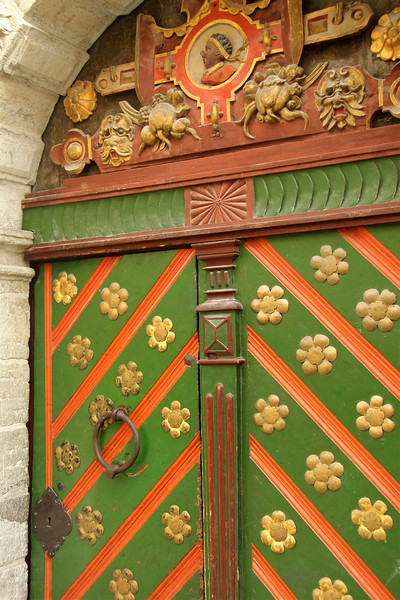 This nearly 360 year old magnificently ornamented, eye catching door opens into the House of the Brotherhood of the Blackheads (an association of local unmarried merchants, ship owners, and foreigners active from the mid 14th century until 1940.) -Tallinn, Estonia