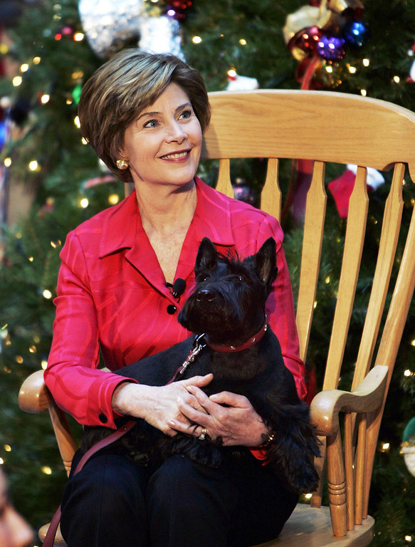 . First lady Laura Bush, holds her pet dog Barney during a visit to the Children\'s National Medical Center, Wednesday, Dec. 15, 2004, in Washington. The visit has been a holiday tradition for the U.S. first ladies each year starting with Mrs. Jacqueline Kennedy. (AP Photo/Manuel Balce Ceneta)