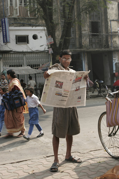 Newspaper reader, Calcutta, Kolkata