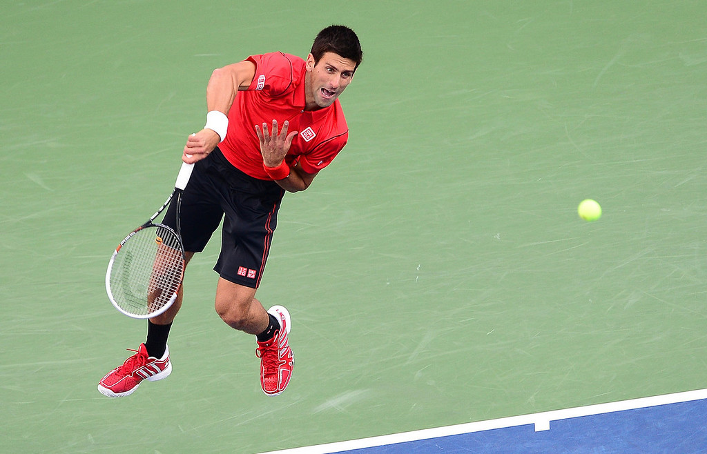 . Serbian tennis player Novak Djokovic plays a point against Spain\'s Rafael Nadal during the 2013 US Open men\'s final at the USTA Billie Jean King National Tennis Center in New York on September 9, 2013.   EMMANUEL DUNAND/AFP/Getty Images