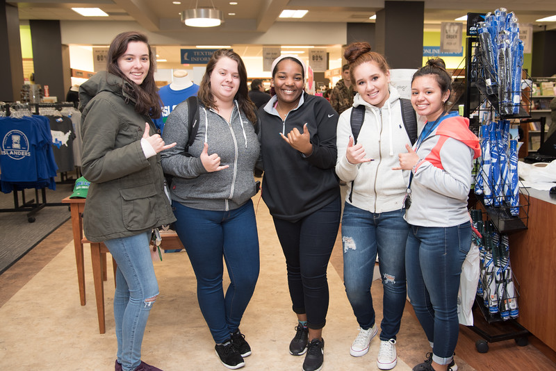 Logean Philbrick (left), Katie Jankowski, Areeona Young, Ashley Moore, and Sabel Sanchez throw some shakas at the Barnes & Noble at TAMU-CC on the first week of classes.
