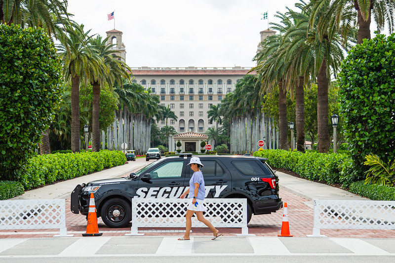 The entrance to The Breakers in Palm Beach is closed as a woman passes by, Friday, April 24, 2020. The Breakers has been closed since Wednesday, March 18 due to the coronavirus pandemic. [JOSEPH FORZANO/palmbeachdailynews.com]