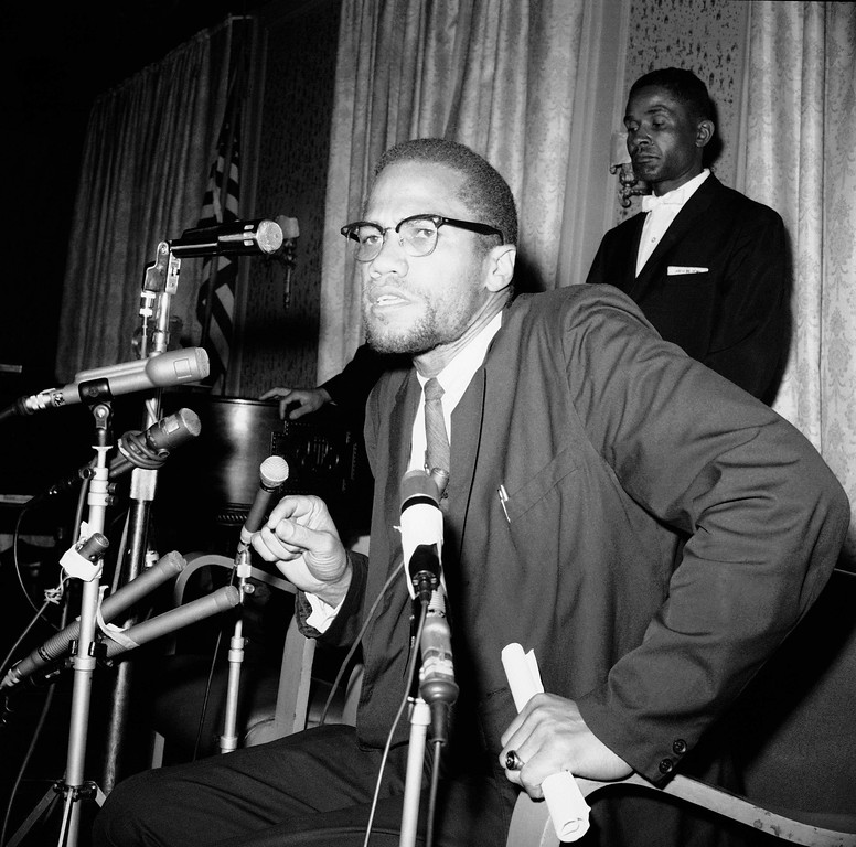 . Nation of Islam leader Malcolm X speaks to television newsmen at Duffy Square, in New York City, Feb. 13, 1963. The Black Muslims were picketing through the Times Square area.  (AP Photo/Marty Lederhandler)
