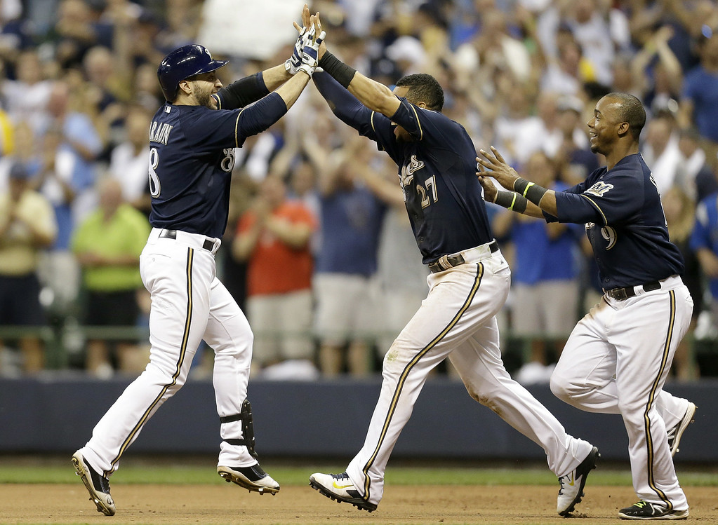 . MILWAUKEE, WI - JUNE 27: Ryan Braun #8 of the Milwaukee Brewers celebrates after hitting a walk off single in the bottom of the ninth inning to put the brewers up 3-2 over the Colorado Rockies at Miller Park on June 27, 2014 in Milwaukee, Wisconsin. (Photo by Mike McGinnis/Getty Images)