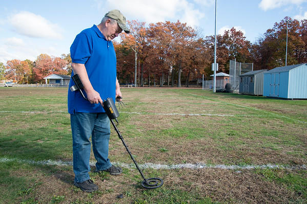 10/28/19 Wesley Bunnell | StaffrrBruce Morley of Plainville uses a metal detector at Norton Park on Monday afternoon. Morley, who lives near the park, uses his detector several times a week until the first snow fall.