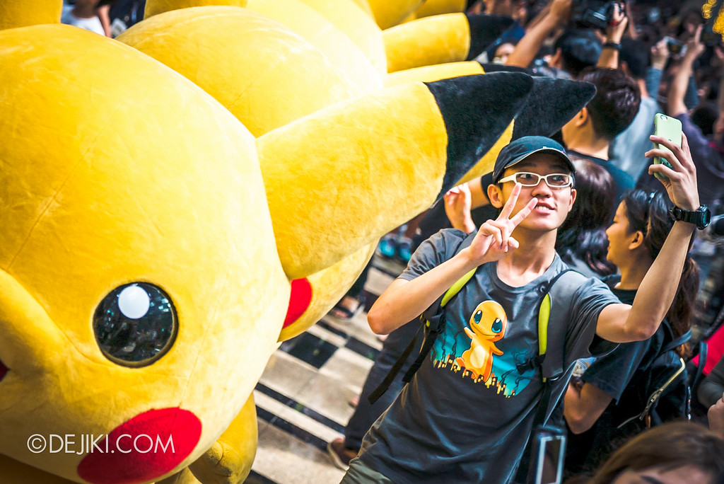 Pokémon at Changi Airport - Pikachu Parade crowd madness selfie