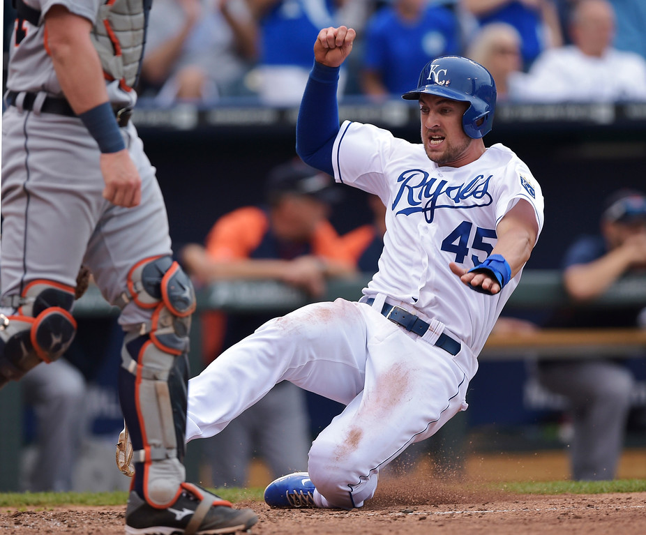 . Kansas City Royals pinch runner Lane Adams (45) scores to bring the Royals within one run of the Detroit Tigers during the eighth inning of a baseball game Saturday, Sept. 20, 2014, in Kansas City, Mo. (AP Photo/Reed Hoffmann)