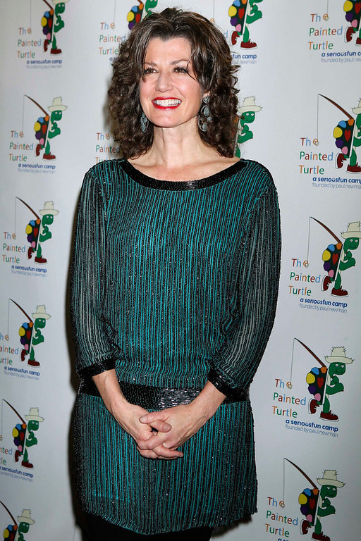 """. Singer and songwriter Amy Grant poses on the arrivals line at \""""A Celebration of Carole King And Her Music\"""" concert to benefit Paul Newman\'s The Painted Turtle Camp in Hollywood December 4, 2012. Grant performed at the concert. The Painted Turtle Camp provides year round camp and hospital outreach programs to children with chronic and life-threatening illnesses at no charge. REUTERS/Fred Prouser"""