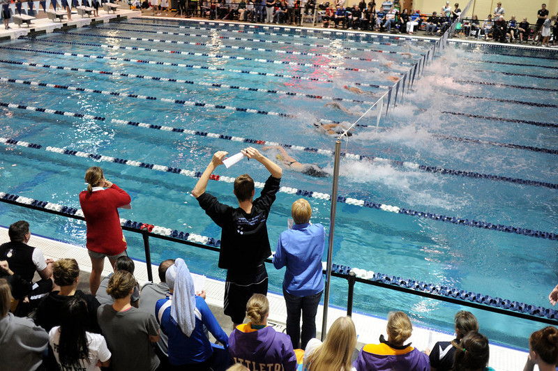 . Fans cheered on the racers competing in the 50-Yard Freestyle sprint Saturday. The Colorado Coaches Invitational Swimming and Diving Meet wrapped up Saturday night, December 15, 2012.  Karl Gehring/The Denver Post