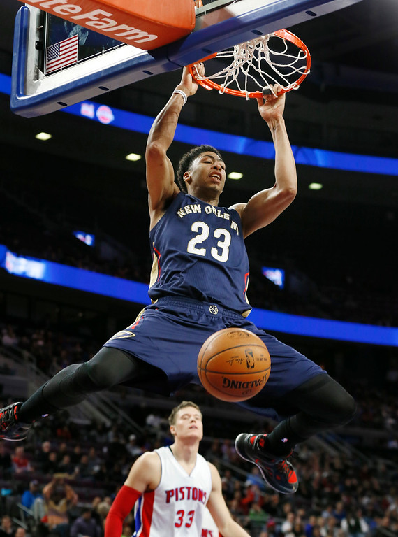 . New Orleans Pelicans forward Anthony Davis (23) dunks against the Detroit Pistons during the second half of an NBA basketball game in Auburn Hills, Mich., Wednesday, Jan. 14, 2015. (AP Photo/Paul Sancya)