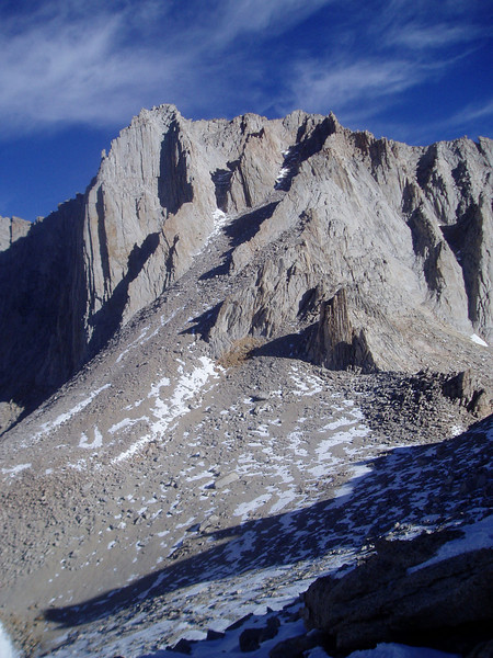 View on the Mt. Russell West summit (left) and East summit (right) from the pass. Climbing routes: Mithral Dihedral and Fishhook Arete on the left, East Arete in the center (of the image)