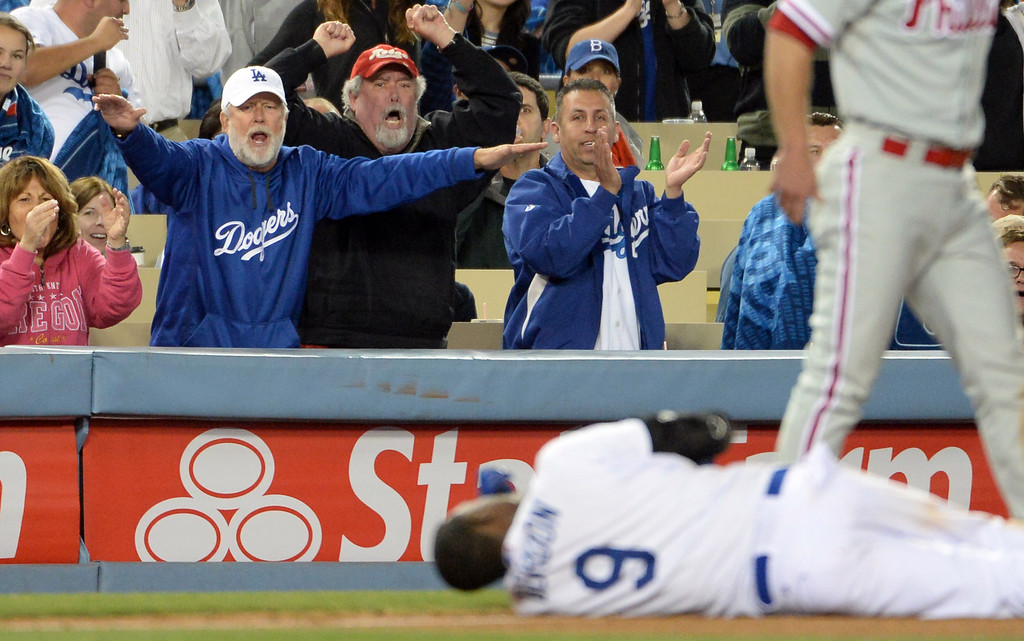 . Los Angeles Dodgers fans react after Dee Gordon (9) steals third base in the seventh inning of a baseball game against the Philadelphia Phillies on Tuesday, April 22, 2013 in Los Angeles.   (Keith Birmingham/Pasadena Star-News)