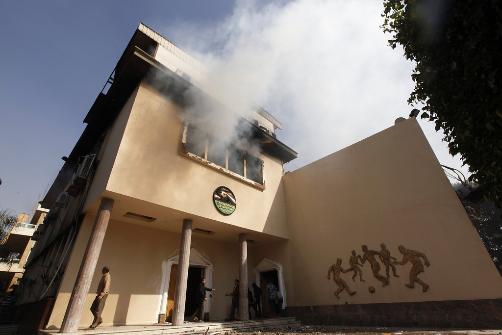 """. Smoke rises from the Egyptian Soccer Federation building after Al Ahly fans, also known as \""""Ultras\"""" set fire to it following a court verdict, in Cairo March 9, 2013. An REUTERS/Amr Abdallah Dalsh"""