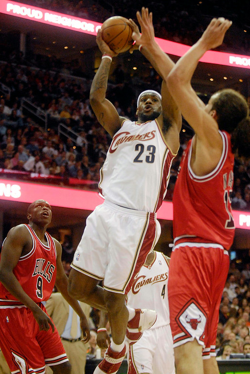 . Bridget Commisso/Bcommisso@News-Herald.com  The Cavs\' Lebron James attempts a shot in the first quarter as the Bulls Joakim Noah tries toi block him. Also seen in background is the Bulls Loul Deng.