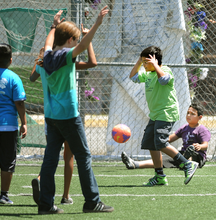 . A score as kids played soccer after watching the World Cup soccer game between Brazil and Mexico at Boys & Girls Club of East Los Angeles at 324 MCDonnell Avenue in Los Angeles, Tuesday, June3 17, 2014.(Photo by Walt Mancini/Pasadena Star-News)