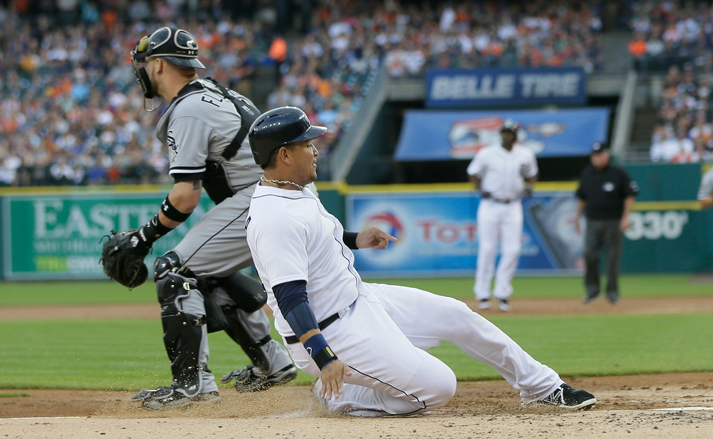 . Detroit Tigers\' Miguel Cabrera beats the throw to Chicago White Sox catcher Tyler Flowers during the first inning of a baseball game, Wednesday, July 30, 2014 in Detroit. (AP Photo/Carlos Osorio)
