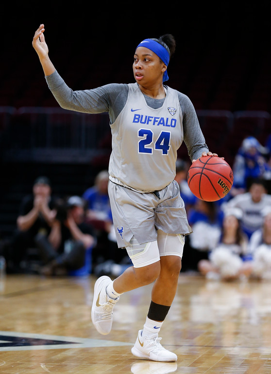 . Buffalo guard Cierra Dillard brings the ball up the floor during the first half of an NCAA college basketball game against Central Michigan in the championship of the Mid-American Conference tournament Saturday, March 10, 2018, in Cleveland. (AP Photo/Ron Schwane)