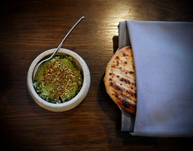 Amass: fermented potato bread with almond ricotta, kale & swiss chard
