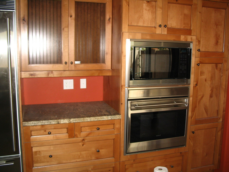 The refrigerator on the far left, and the microwave and oven on the right.