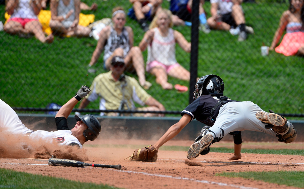 . LAKEWOOD, CO - MAY 23: Durango\'s Jeremy Szura is safe at home as he gets past Green Mountain\'s catcher Justin Akiyama. The Durango Demons take on the Green Mountain Rams in the 4A Baseball State Semi-Final Championships. (Kathryn Scott Osler, The Denver Post)
