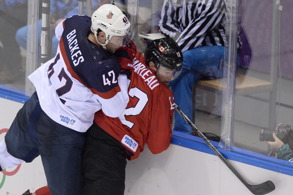 . Canada\'s Patrick Marleau (R) fight for the puck with US David Backes during the Men\'s Ice Hockey Semifinals USA vs Canada at the Bolshoy Ice Dome during the Sochi Winter Olympics on February 21, 2014.    ALEXANDER NEMENOV/AFP/Getty Images