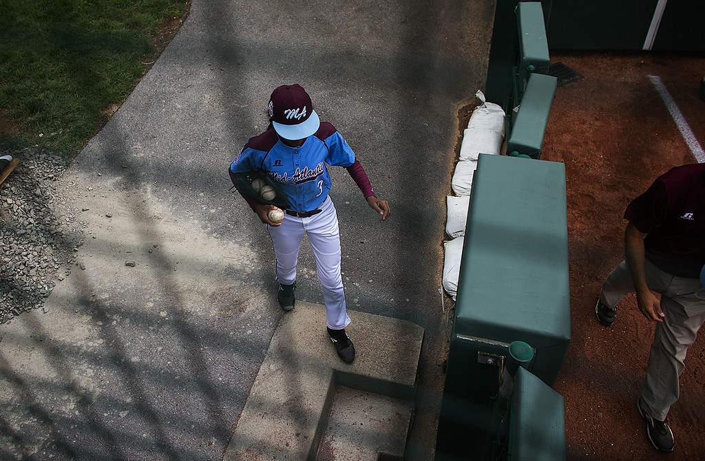 . Philadelphia\'s Mo\'ne Davis enters the field prior to her team\'s 4-0 win over Nashville in a U.S. pool play baseball game at the Little League World Series, Friday, Aug. 15, 2014, in South Williamsport, Pa. (AP Photo/PennLive.com, Sean Simmers)