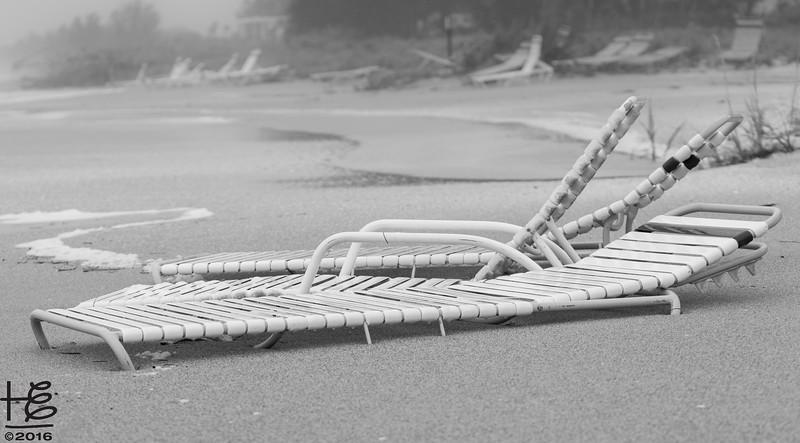 Sand-buried lounge chairs
