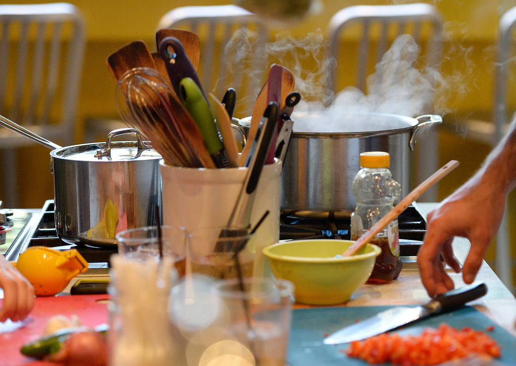 . DENVER, CO - JUNE 6:  The water boils on the stove as the Stir Cooking School at 3215 Zuni Street in Denver, hosted an Iron Chef styled cooking event  on Friday, June 6, 2014.  The evening pitted three tables competing against one another.  (Denver Post Photo by Cyrus McCrimmon)