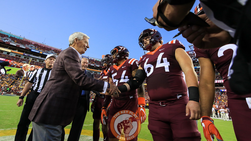 Former Virginia Tech head coach Frank Beamer shakes hands with his former players before the coin toss. (Mark Umansky/TheKeyPlay.com)